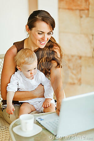 young-mother-working-baby-laptop-24246947